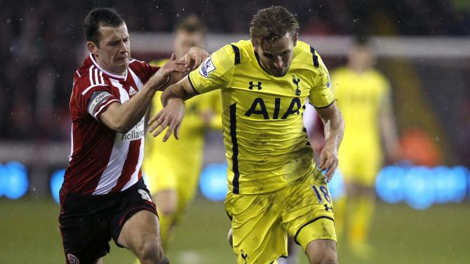 Sheffield United's Doyle challenges Tottenham Hotspur's Kane during their Capital One Cup semi final second leg soccer match at Bramall Lane in Sheffield