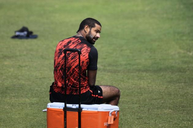 India's Shikhar Dhawan sits on a box during a practice session ahead of the Asia Cup tournament in Dhaka, Bangladesh, Monday, Feb. 24, 2014. Pakistan plays Sri Lanka in the opening match of the five n
