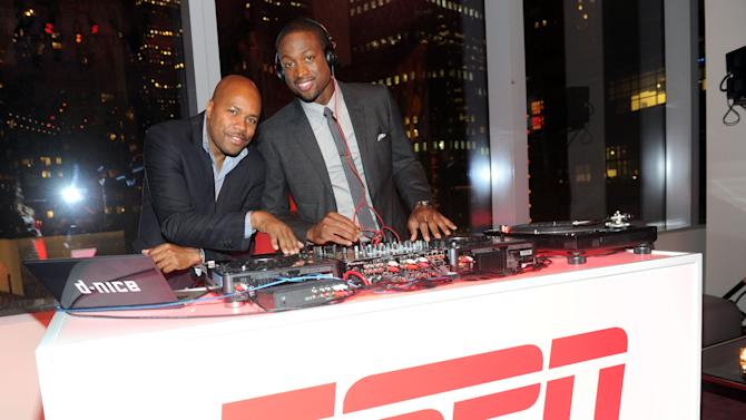 "NBA champion and Miami Heat shooting guard Dwyane Wade, right, and DJ D-Nice celebrate the launch of Wade's first book ""A Father First: How My Life Became Bigger Than Basketball,"" at a party hosted by ESPN The Magazine, Tuesday, Sept. 4, 2012, at Jazz at Lincoln Center in New York. (Diane Bondareff/Invision for ESPN The Magazine/AP Images)"