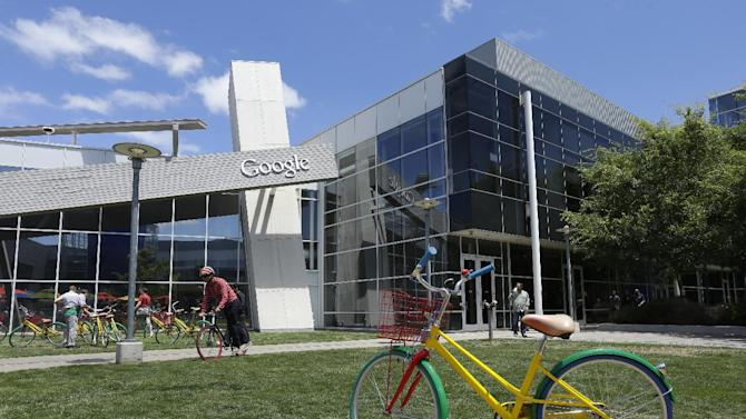 Employees travel around campus via bicycles at Google headquarters Tuesday, July 16, 2013, in Mountain View, Calif. Google reports quarterly earns on Thursday, July 18, 2013. (AP Photo/Ben Margot)