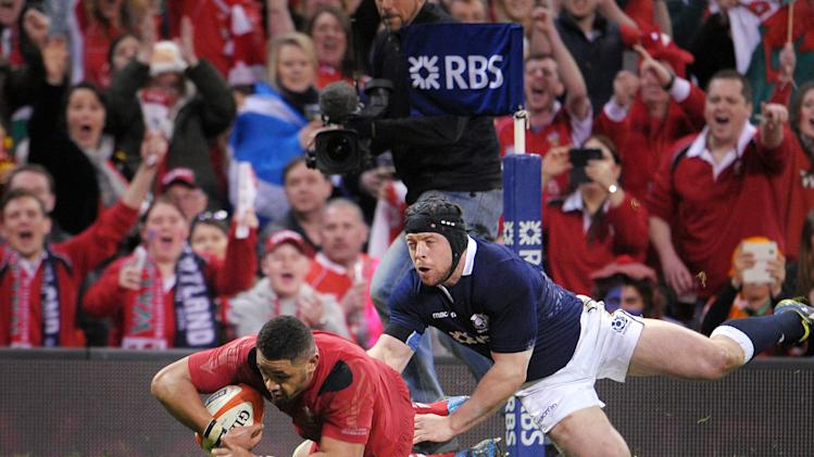 Wales' Taulupe Faletau, left, scores a try during the Six Nations rugby union match at the Millennium Stadium, Cardiff, Wales, Saturday, March 15, 2014. (AP Photo/Tim Ireland, PA Wire) UNITED KINGDOM OUT - NO SALES - NO ARCHIVES