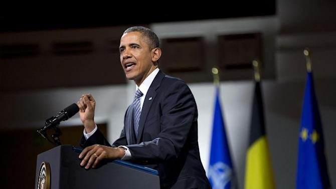 President Barack Obama speaks at the Palais des Beaux-Arts, Wednesday, March 26, 2014, in Brussels, Belgium. Obama is on a one day trip to Belgium to shore up commitments he received from allies in The Hague, Netherlands, to reassure Eastern Europeans members of NATO that the alliance will stand by them and to make a larger point about European security a quarter-century after the fall of the Iron Curtain. (AP Photo/Pablo Martinez Monsivais)