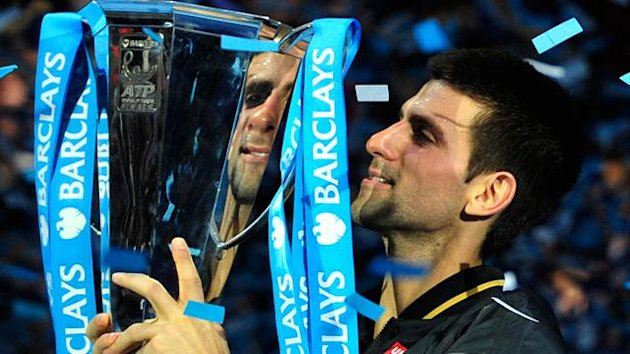 Novak Djokovic holds the 2012 ATP World Tour Finals trophy after beating Roger Federer at the O2 Arena in London on November 12