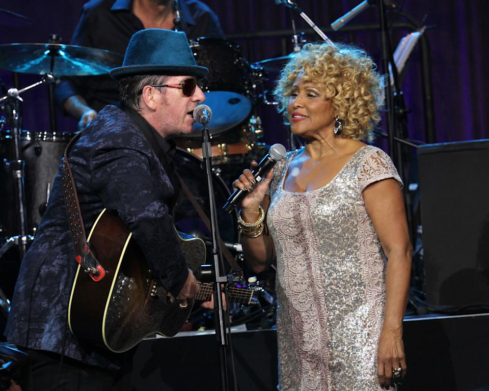 "Singers Elvis Costello and Darlene Love perform at the ""Right To Rock Benefit"" at Cipriani Wall Street, on Thursday, Oct. 17, 2013 in New York. (Photo by Greg Allen/Invision/AP)"