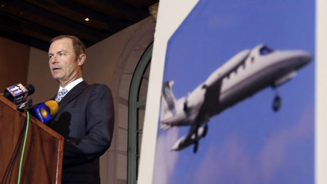 Aircraft expert Mark Schmaltz speaks next to a photo of the type of aircraft involved as attorneys announce a lawsuit on behalf of four associates of Mexican singer Jenni Rivera, who perished along with her in a plane crash in Mexico in December, at a news conference in Los Angeles Thursday, Jan. 10, 2013. (AP Photo/Reed Saxon)