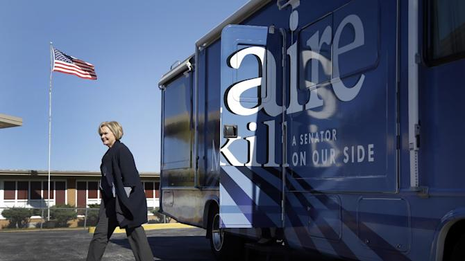Sen. Claire McCaskill, D-Mo. steps off her campaign bus to speak to the media outside Bayless Elementary School, Wednesday, Oct. 31, 2012, in St. Louis County, Mo. The incumbent, who is running for re-election against Rep. Todd Akin, R-Mo., held her first public appearance since the passing of her mother, Betty Anne Ward McCaskill, on Monday. (AP Photo/Jeff Roberson)