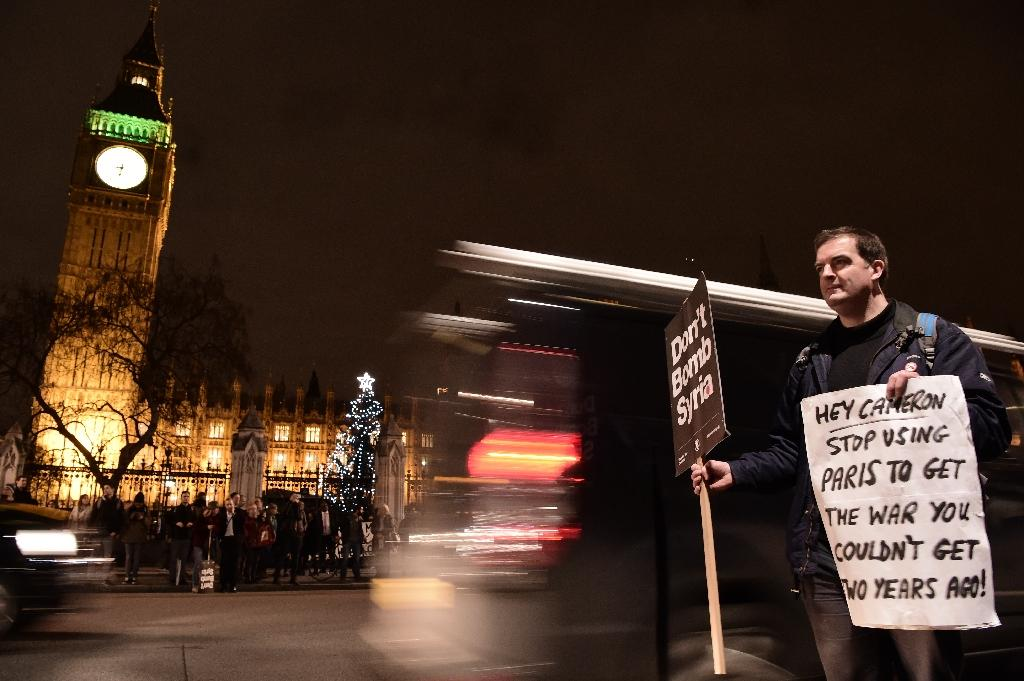 Anti-war protesters march in London on eve of Syria strikes vote
