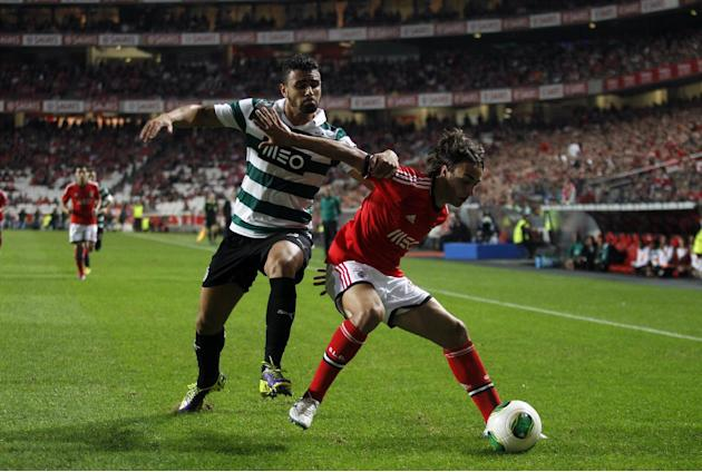 Benfica's Lazar Markovic, right, from Serbia vies for the ball with Sporting's Mauricio Nascimento from Brazil during a Portugal Cup soccer match between Benfica and Sporting at Benfica's Luz stadium