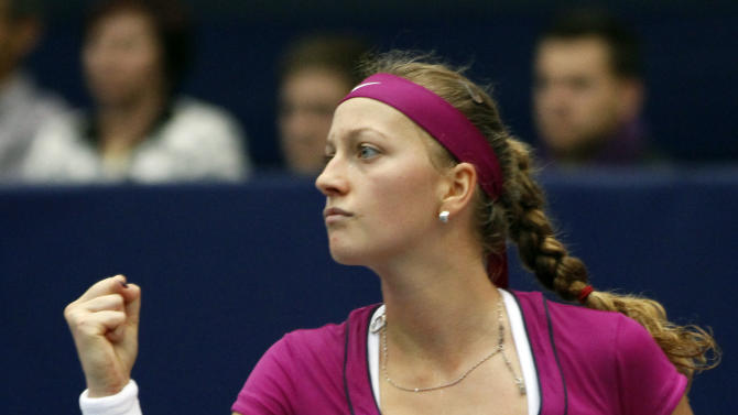 Czech Republic's Petra Kvitova reacts during the final tennis match against Dominika Cibulkova of Slovakia at the WTA Generali Ladies tennis tournament in Linz, Austria, on Sunday, Oct. 16, 2011.Wimbledon champion Petra Kvitova beat Dominika Cibulkova of Slovakia 6-4, 6-1 Sunday to win the Generali Ladies for her fifth title of the season and sixth overall. The top-seeded Kvitova, ranked on a career-high fourth, is now 6-2 in career finals. The seventh-seeded Cibulkova, who is yet to win a title, was in her first final since 2008. Only top-ranked Caroline Wozniacki, who won six events, has earned more WTA titles this season than Kvitova.  (AP Photo/Ronald Zak)