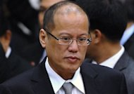 Philippine President Benigno Aquino looks on before the closing session of the 20th summit of the Association of Southeast Asian Nations (ASEAN) in Phnom Penh on April 4 . Manila's land reform agency has said it is ready to carve up the vast farm of Aquino's clan, which lost a Supreme Court battle for USD$100 million in compensation