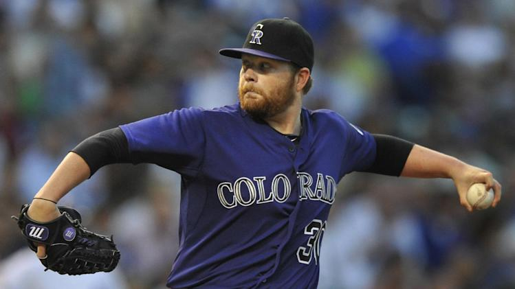 Colorado Rockies starter Brett Anderson delivers a pitch during the first inning of a baseball game agains the Chicago Cubs in Chicago, Wednesday, July 30, 2014. (AP Photo/Paul Beaty)