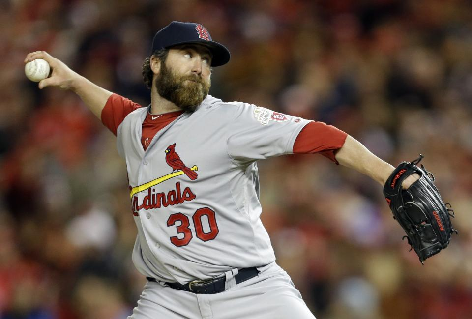 St. Louis Cardinals relief pitcher Jason Motte throws to the Washington Nationals in the eighth inning of Game 5 of the National League division baseball series on Friday, Oct. 12, 2012, in Washington. (AP Photo/Pablo Martinez Monsivais)