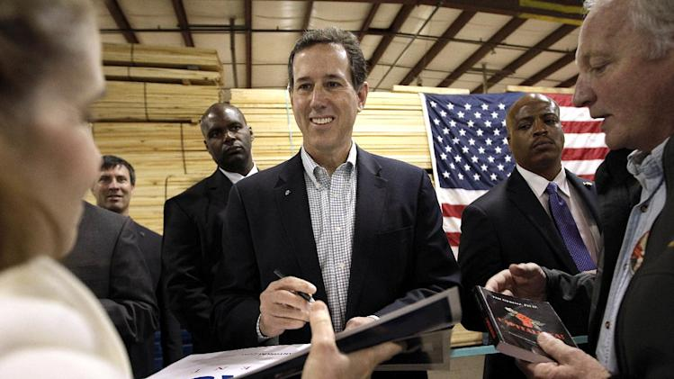 Republican presidential candidate, former Pennsylvania Sen. Rick Santorum signs his autographs in Sparta, Wis., Wednesday, March 28, 2012. (AP Photo/Jae C. Hong)