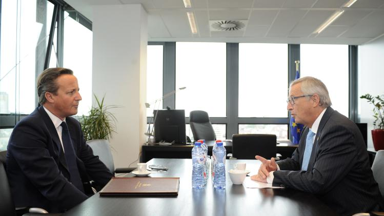 Britain's Prime Minister Cameron talks with Elected President of the European Commission Juncker, prior to an EU summit at theEuropean Commission Charlemagne building in Brussels