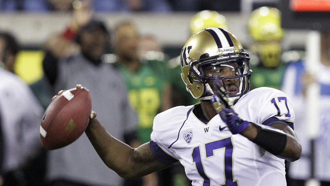 Washington quarterback Keith Price looks for a receiver during the first half of an NCAA college football game against Oregon in Eugene, Ore., Saturday, Oct. 6, 2012. (AP Photo/Don Ryan)