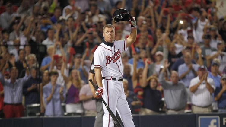Atlanta Braves' Chipper Jones tips his helmet to the crowd at his last at-bat during the ninth inning of the National League wild card playoff baseball game against the St. Louis Cardinals, Friday, Oct. 5, 2012, in Atlanta. The Cardinals won baseball's first wild-card playoff, taking advantage of a disputed infield fly call that led to a protest and fans littering the field with debris to defeat the Braves 6-3. (AP Photo/John Bazemore)