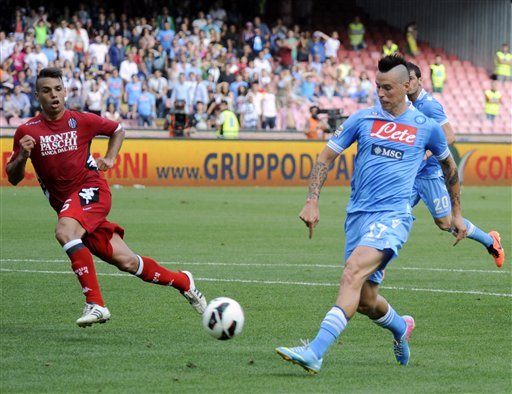 Napoli's Marek Hamsik, of Slovakia, scores during a Serie A soccer match between Napoli and Siena, at the Naples San Paolo stadium, Italy, Sunday, May 12, 2013