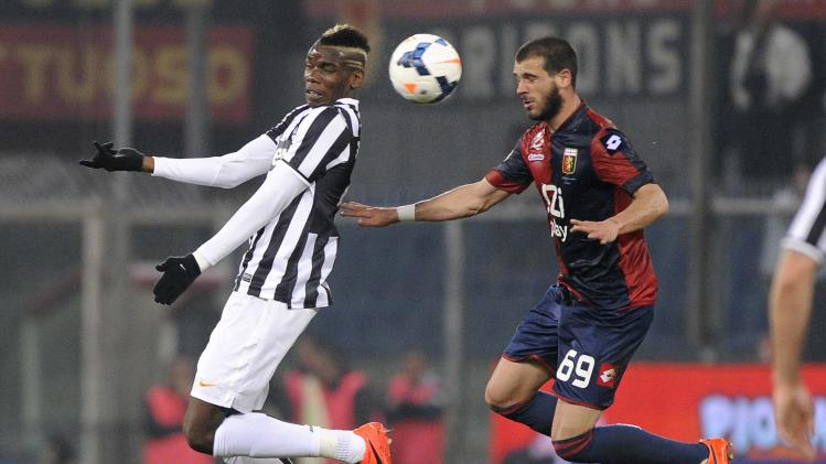 Juventus' Pogba fights for an aerial ball with Genoa's Sturaro during their Italian Serie A soccer match at Luigi Ferraris stadium in Genoa