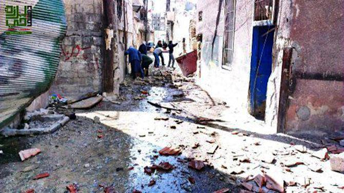 This citizen journalism image provided by the Local Council of Barzeh, which has been authenticated based on its contents and other AP reporting, shows the aftermath of rocket attacks on the Barzeh district of Damascus, Syria, Friday, April 5, 2013. A barrage of rockets slammed into a contested district on the northeastern edge of Damascus, killing several people and trapping others under the rubble, while violence raged around suburbs of the capital, activists said Friday. The attack on Barzeh, where rebels aiming to topple President Bashar Assad are known to operate, follows days of heavy fighting between the rebels and the military in the area.(AP Photo/Local Council of Barzeh)
