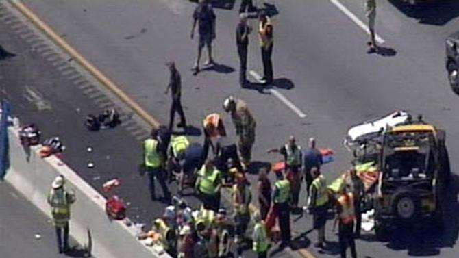 In this image taken from video from WHAS11-TV, emergency crews respond to a crash involving a bus carrying students on a college campus visit on on Interstate 64 near the Shelby County line in Louisville, Ky. on Tuesday, June 11, 2013. The bus was a charter service and had 42 students aboard, said Jefferson County public schools spokesman Ben Jackey. All the students, sophomores and juniors from Waggener High School in Louisville, were taken to area hospitals, he said. (AP Photo/WHAS11-TV) MANDATORY CREDIT