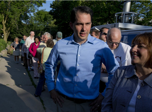 Wisconsin Republican Gov. Scott Walker waits in line to vote Tuesday, June 5, 2012, in Wauwatosa, Wis. Walker faces Democratic challenger Tom Barrett in a special recall election. (AP Photo/Morry Gash