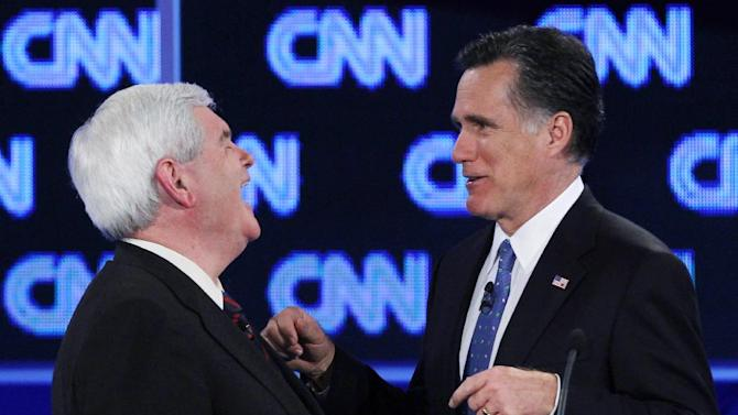 """FILE - In this Jan. 26, 2012 file photo, Republican presidential candidates, former House Speaker Newt Gingrich and former Massachusetts Gov. Mitt Romney talk during a commercial break at the Republican presidential candidates debate in Jacksonville, Fla. Remember Gingrich calling Romney a liar? Michele Bachmann saying Romney's unelectable? Rick Santorum calling Romney """"the worst Republican in the country"""" to run against Obama? They're hoping you don't. And acting like it never happened _ even though most of their words are just clicks away online. (AP Photo/Matt Rourke, File)"""