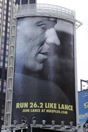 """FILE - In an 80-foot billboard at 34th Street and 7th Avenue in Manhattan, Lance Armstrong and Nike challenge New Yorkers to """"Run Like Lance"""" in an Oct. 2, 2006 file photo. Nike said Wednesday, Oct. 17, 2012 that it is severing ties with Armstrong, citing insurmountable evidence that the cyclist participated in doping and misled the company for more than a decade.   (PRNewsFoto/NIKE, Inc., File)"""