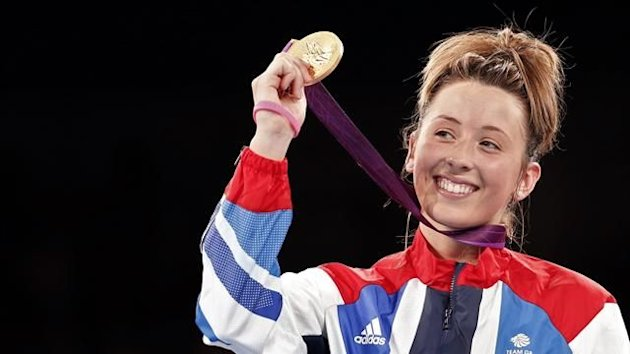Gold medallist Britain's Jade Jones poses at the women's -57kg taekwondo victory ceremony at the London 2012 Olympic Games at the ExCeL Arena (Reuters