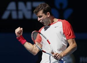 Grigor Dimitrov of Bulgaria reacts during his men's singles quarter-final tennis match against Rafael Nadal of Spain at the Australian Open 2014 tennis tournament in Melbourne