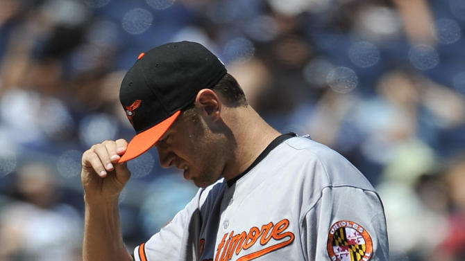Baltimore Orioles starting pitcher Chris Tillman (24) reacts after New York Yankees' Nick Swisher hit a two-run home run in the fourth inning of the first baseball game of a doubleheader on Saturday, July 30, 2011 at Yankee Stadium in New York. The Yankees won 8-3. (AP Photo/Kathy Kmonicek)