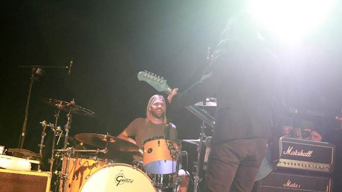 Taylor Hawkins and Dave Grohl, of the Foo Fighters perform with the Sound City Players at Park City Live Day 2 on Friday, January 18, 2013, in Park City, Utah. (Photo by Barry Brecheisen/Invision for Park City Live/AP Images)