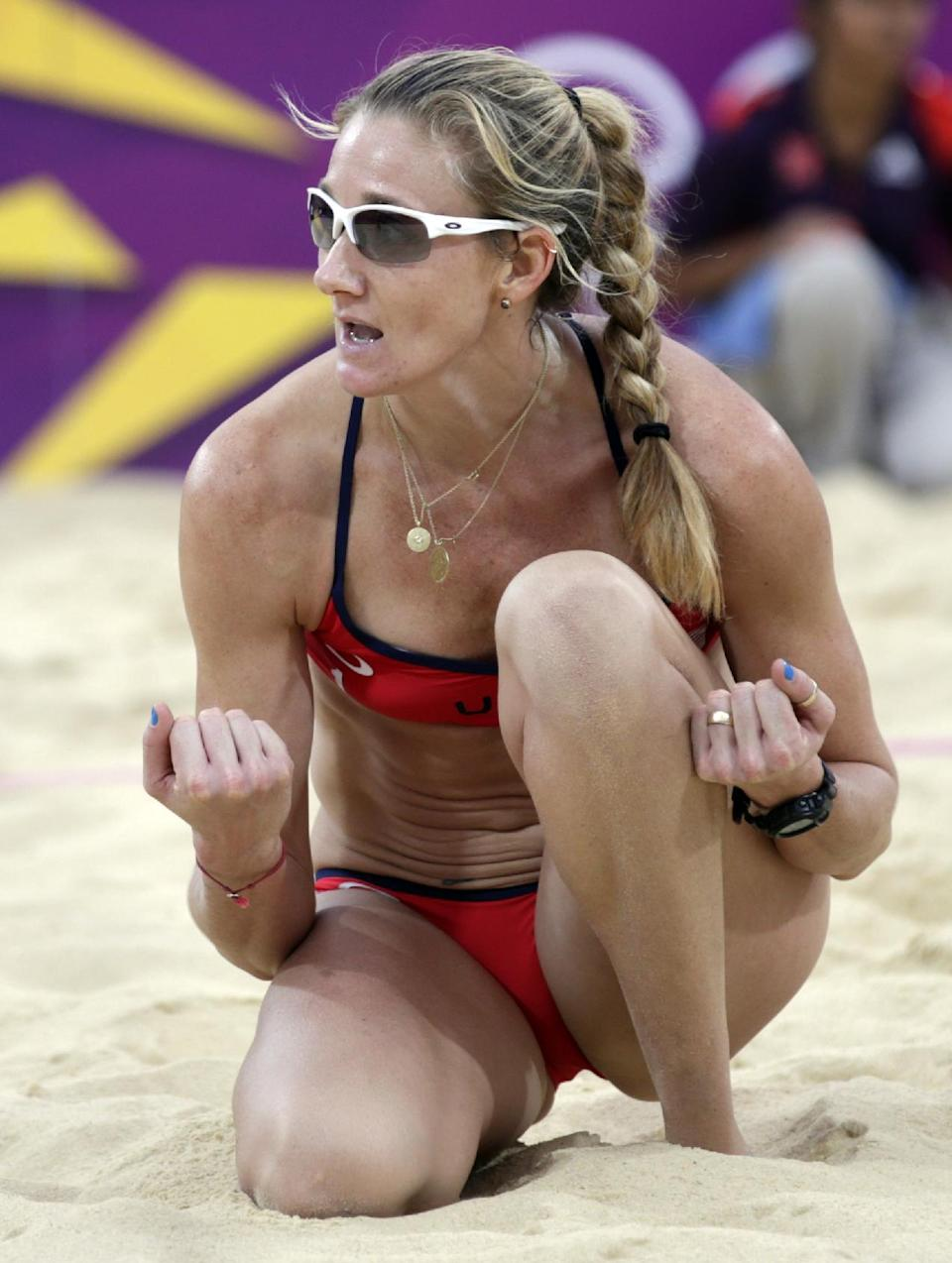 Kerri Walsh Jennings of the United States reacts after winning the first set during a women's semi-final beach volleyball match against China at the 2012 Summer Olympics, Tuesday, Aug. 7, 2012, in London. (AP Photo/Dave Martin)