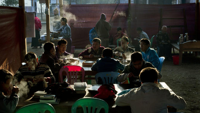 In this photo taken on Feb 12, 2013, camp residents eat breakfast at dawn at the Kachin Baptist Convention's rehabilitation camp in Myitkyina, the provincial capital of Kachin state, Myanmar. Myitkyina is known for having one of the highest concentrations of drug addicts in the world. The Kachin Baptist Convention, an evangelical group with over 300 churches in the state, says nearly 80 percent of ethnic Kachin youth are addicts. Their drug of choice is heroin. In the shadow of war, even drug abuse becomes politicized. Gryung Heang, the pastor of the camp church, says the government is willfully turning a blind eye to drug abuse among the Kachin because it wants to decimate young potential fighters. Officials say such views are absurd. (AP Photo/Gemunu Amarasinghe)
