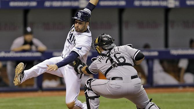 Chicago White Sox catcher Josh Phegley (36) tags out Tampa Bay Rays' Kevin Kiermaier at the plate after Kiermaier tried to score from first base on an error by White Sox second base Marcus Semien during the seventh inning of a baseball game Friday, Sept. 19, 2014, in St. Petersburg, Fla. (AP Photo/Chris O'Meara)
