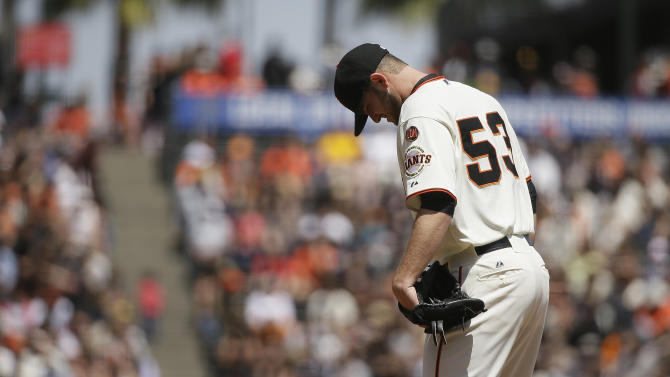 San Francisco Giants starting pitcher Chris Heston stands on the mound after the San Diego Padres scored their fifth run in the third inning of their baseball game Wednesday, May 6, 2015, in San Francisco. (AP Photo/Eric Risberg)