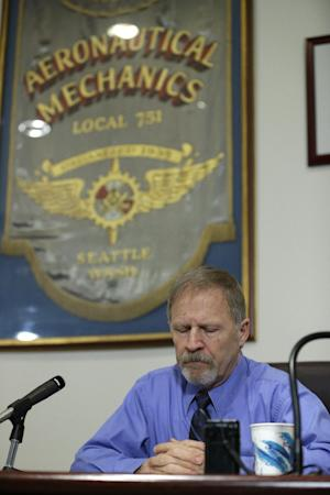 Jim Bearden, administrative assistant for District 751 of the Boeing machinists union, tells reporters that workers voted to accept Boeing's latest contract offer to keep the assembly of the Boeing 777X airplane in Washington state, Friday, Jan. 3, 2014, in Seattle. (AP Photo/Ted S. Warren)