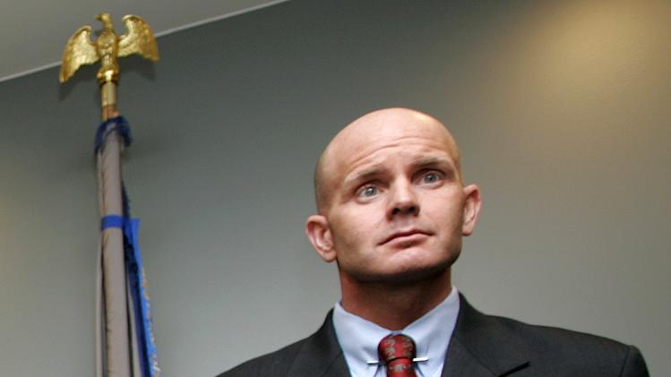 In this July 27, 2005 photo, FBI agent Frederick Humphries appears during a news conference after the sentencing of Ahmed Ressam at the Federal Courthouse in Seattle. Humphries has been identified as the agent socialite Jill Kelley contacted to complain about harassing emails sent by Gen. David Petraeus' paramour, Paula Broadwell.  (AP Photo/Kevin P. Casey)