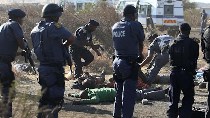 South African police shoot, kill striking miners