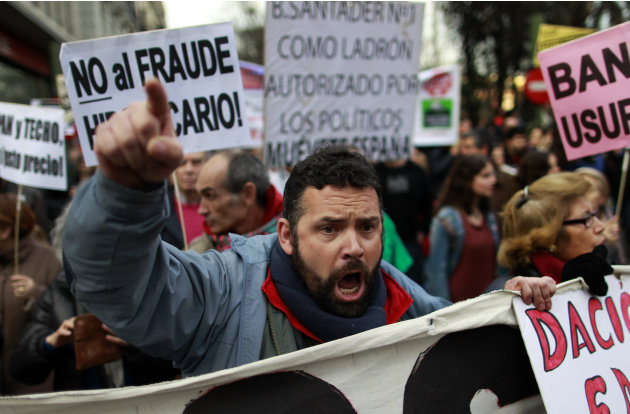 A demonstrator shout slogans to change mortgage laws and halt evictions of those unable to pay mortgages in Madrid, Saturday, Feb. 16, 2013. The government agreed to consider changes to the law on mor