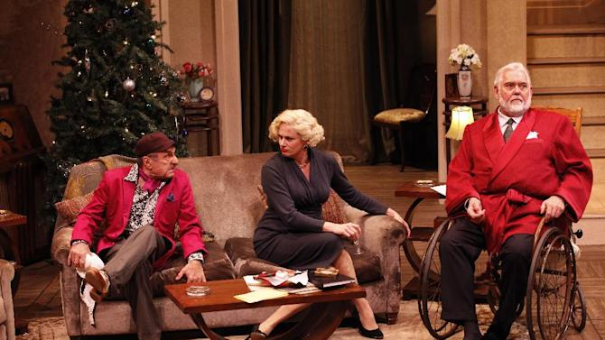 """In this theater publicity image released by Jim Randolph Media Relations, from left, Joseph R. Sicari, Cady Huffman and Jim Brochu are shown in a scene from """"The Man Who Came to Dinner,"""" in New York. (AP Photo/Jim Randolph Media Relations, Carol Rosegg)"""