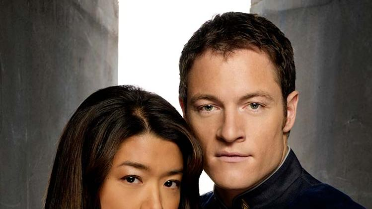 "Grace Park as Sharon Valerii and  Tahmoh Penikett as Karl ""Helo"" Agathon in Battlestar Galactica on the Sci Fi Channel."