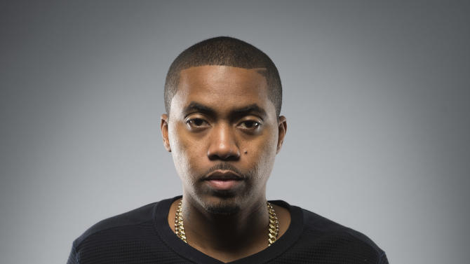 """This Dec. 20, 2012 photo shows American rapper and actor Nas, born Nasir Jones, posing in New York. Nas is nominated for four Grammys, including best rap album for """"Life Is Good,"""" best rap song and best rap performance for """"Daughters,"""" and best rap/sung collaboration for """"Cherry Wine,"""" which features the late Amy Winehouse. The Grammy Awards will air live Feb. 10. (Photo by Scott Gries/Invision/AP Images)"""