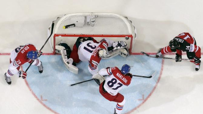 Canada's Eberle wraps around a goal past goaltender Pavelec of the Czech Republic during their Ice Hockey World Championship game at the O2 arena in Prague