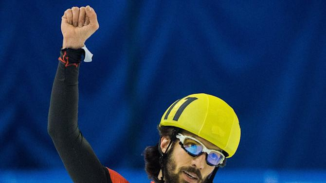 Charles Hamelin of Canada celebrates after he won the bronze medal in men's 1500m at the  Short Track Speed Skating World Championships in Debrecen, Hungary, Friday, March 8, 2013. (AP Photo/MTI, Tibor Illyes)