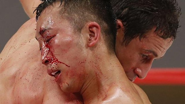 Takahiro Aoh (front) of Japan and Gamaliel Diaz of Mexico fight during their World Boxing Council (WBC) super featherweight boxing title bout in Tokyo