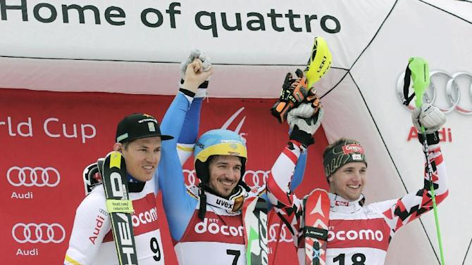 Men's World Cup slalom winner Felix Neureuther, center, of Germany smiles with second placer, Andre Myhrer, left, of Sweden and third placer Marco Schwarz of Austria during the awarding ceremony at the FIS Alpine Ski World Cup Sunday, Feb. 14, 2016, in Yuzawa, northern Japan. Neureuther, fifth after the first run, clocked a time of 56.96 seconds in the second run to finish 0.05 seconds ahead of Myhrer to win the event. Schwarz was third, 0.24 off the pace. (Yusuke Ogata/Kyodo News via AP)  JAPAN OUT, MANDATORY CREDIT