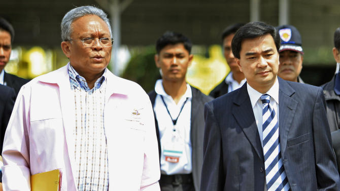 FILE - In this May 2, 2010 file photo, Thai Prime Minister Abhisit Vejjajiva, right, walks with Deputy Premier Suthep Thaugsuban, left, to attend a special Cabinet meeting in Bangkok, Thailand. Thai law enforcement authorities announced Thursday, Dec. 6, 2012, that they will file murder charges against Abhisit and his deputy in the first prosecutions of officials for their roles in a deadly 2010 crackdown on anti-government protests.  (AP Photo/Wong Maye-E, File)