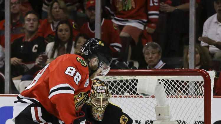 Chicago Blackhawks right wing Patrick Kane (88) scores against Boston Bruins goalie Tuukka Rask (40) in the second period during Game 5 of the NHL hockey Stanley Cup Finals, Saturday, June 22, 2013, in Chicago. (AP Photo/Nam Y. Huh)