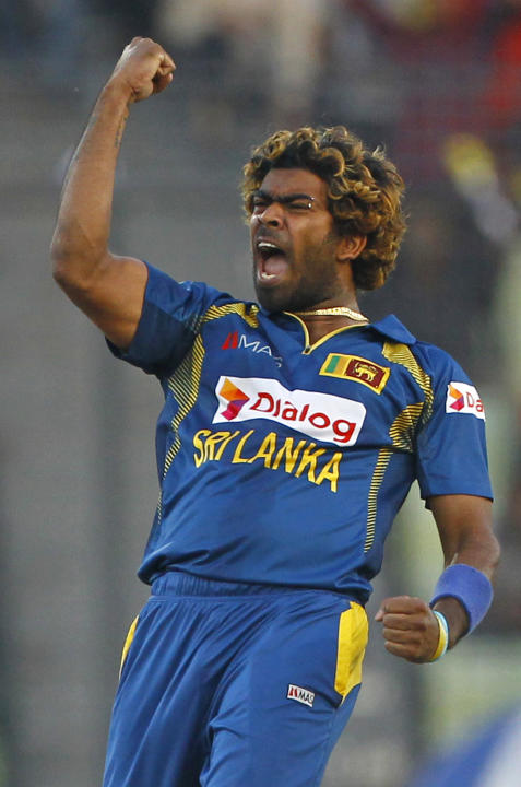 Sri Lanka's Lasith Malinga celebrates tthe dismissal of Pakistan's Umar Akmal during the Asia Cup final cricket match between Sri Lanka and Pakistan in Dhaka, Bangladesh, Saturday, March 8, 2014. (AP