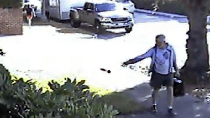 FILE - In this June 7, 2014 file image from from a security video provided by Philip Lao, shows Dennis Kneier, the mayor of San Marino, Calif., tosses a bag of dog waste onto the property of his Lao, in San Marino, Calif. The Pasadena Star-News reports San Marino Mayor Dennis Kneier resigned Tuesday, June 17, 2014 after outcry from residents who say he smeared their image. (AP Photo/Courtesy Philip Lao, File)